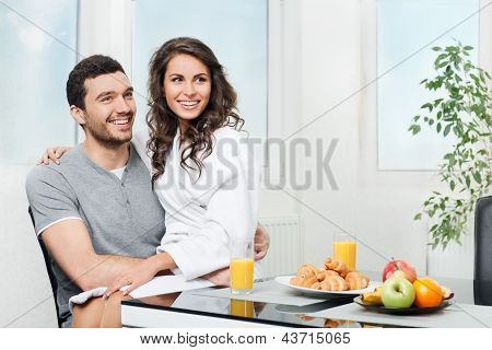 beautiful couple having breakfast