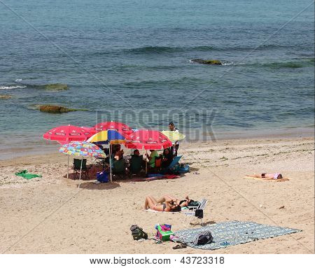 Tel Aviv, Israel - March 16: Unknown People On The Beach In Tel Baruch, Favorite Vacation Spot,  At