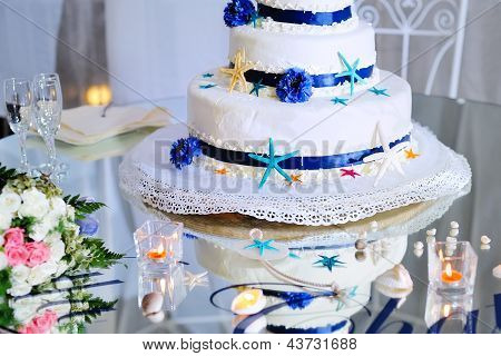 Wedding Cake With Bouquet And Stemware