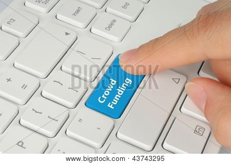 Hand pushing blue crowd funding button