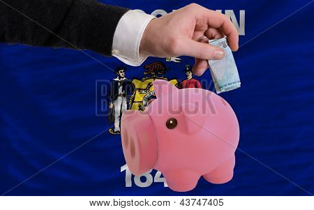 Funding Euro Into Piggy Rich Bank Flag Of American State Of Wisconsin