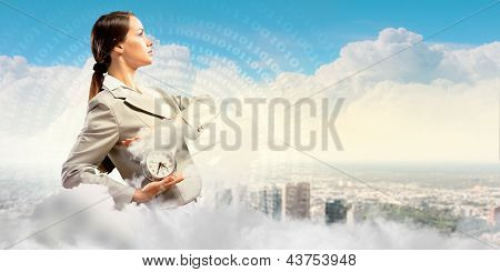 Businesswoman holding alarmclock