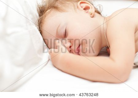 Restful Two Years Baby Girl Sleeping On Bed