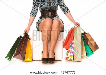 Woman legs in highheels with many shopping bags. Shopping concept.