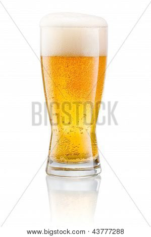 Glass Of Fresh Beer With Cap Of Foam Isolated On A White Background