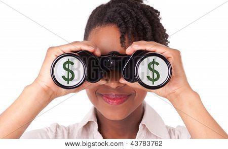Jonge zwart / Afro-Amerikaanse Business Woman met verrekijkers als gevolg van Dollar teken