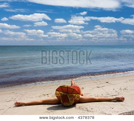 Girl In Hat At Seaside