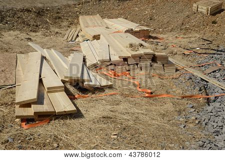Pile Of Loose Wood Planks Or Lumber By A Construction Site
