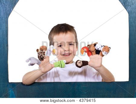 Smiling Kid Playing With Puppets