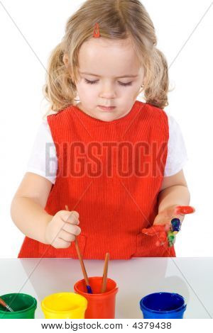 Little Painter Girl Absorbed By The Work