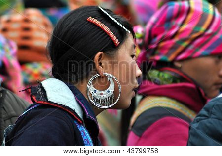 Black and Flower H'mong woman sellers in Sapa market, Vietnam