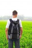 picture of knapsack  - teenager with knapsack in the summer field - JPG