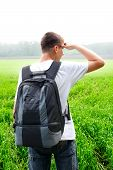 foto of knapsack  - teenager with knapsack in the summer field - JPG