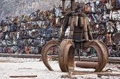 image of discard  - Industrial claw in front of the scrap metal - JPG