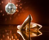stock photo of stiletto  - Beautiful brown stilettos on the dance floor with mirror ball - JPG