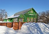 Green Wooden House In Winter