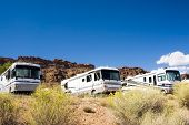 stock photo of motor coach  - recreational vehicles in a campground in the southwest - JPG