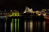 stock photo of tromso  - Tromso by night. The church Ishavskatedralen is the most visible building. 