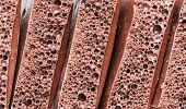 image of aeration  - Aerated porous chocolate as a background on Food theme - JPG