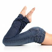 picture of bare butt  - Close up of a beautiful woman legs with jeans and barefoot isolated on a white background - JPG