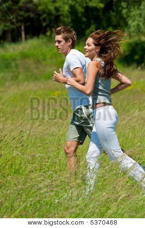 Sportive Couple Jogging In The Nature
