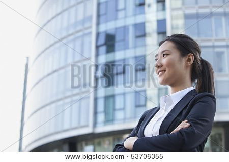 Low angle view of young businesswoman smiling