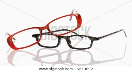 Two Pair Of Eyeglasses