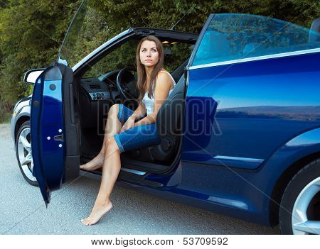 ?aucasian Woman In A Cabriolet
