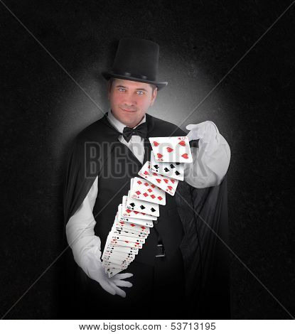 Magician With Trick Cards On Black
