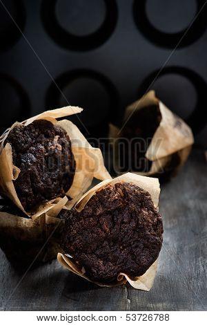 Chocolate muffins over dark background