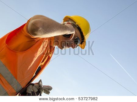 Worker With Helmet And Mobile Phone