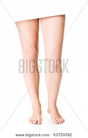 Sexy fmale legs. Closeup. Isolated on white.