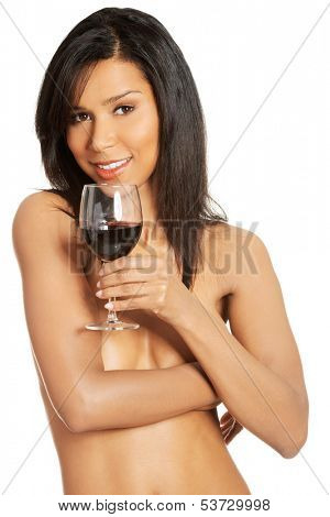 Attractive naked woman with galss of wine. Isolated on white.