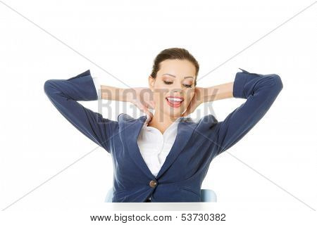 Attractive woman sitting with her hands behind her neck. isolated onw hite.