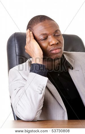 Male businessman sitting, bored, sleeping.  Isolated on white.
