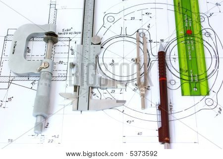 Micrometer Caliper Mechanical Pencil Compass and template ruler on Blueprint