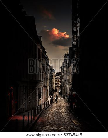 Red cloud over a parisian street