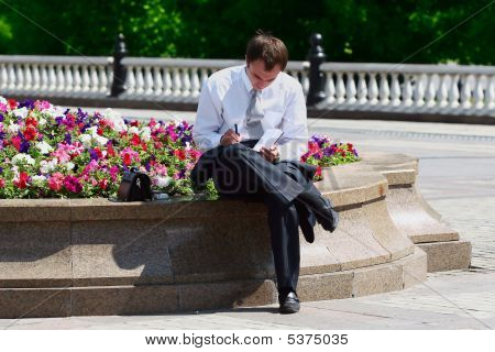 Successful Businessman Working Outdoor