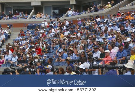 Professional photographers and spectators during US Open 2013 at the Arthur Ashe Stadium