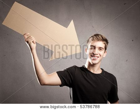 young man pointing to himself with an  arrow cardboard