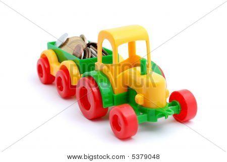 El dinero de las ruedas de excavadora de juguete