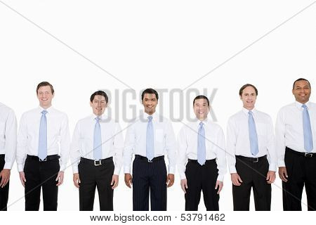 Similar looking businessmen in row
