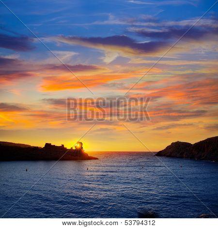 Menorca sunset in Cala Morell at Ses torretes beach Balearic Islands
