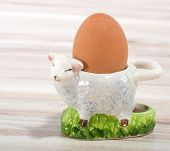 Egg And Lamb Eggcup On A Wooden Background