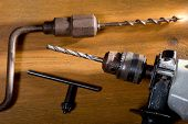 foto of auger  - still life with electric drill and hand auger in the workroom - JPG