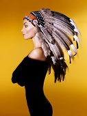 stock photo of shaman  - Fashion art portrait of a young lady in the Indian roach - JPG