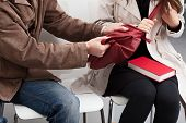 stock photo of yanks  - A thief and a woman yanking on her red bag - JPG