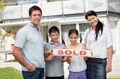 Smiling Young Family Buying New House