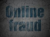 Protection concept: Online Fraud on grunge wall background