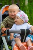 Two Babies In Children Stroller